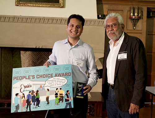 Utkarsh Mital receiving People's Choice Award from Mr. Ernesto Mercardo