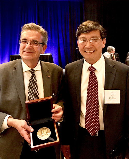 Ares Rosakis receiving the award from J.S. Chen, President of the Engineering Mechanics Institute.