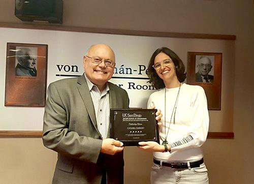 Professor Daraio receiving the award from her PhD advisor Professor Vitali Nesterenko