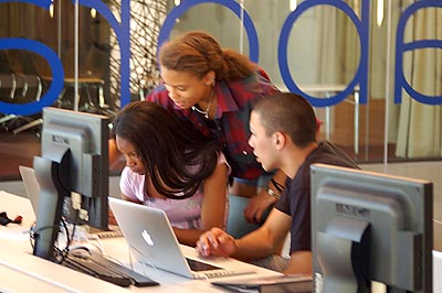 LEAD students Khiana Lowe (standing), Nicole  Crawford (sitting left)  and Pablo Lozano (sitting right)