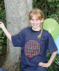 Mackenzie Sikora modeling the new IST t-shirt.